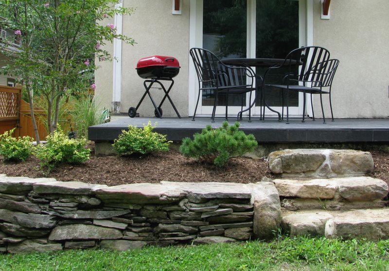 Back yard stone wall and steps